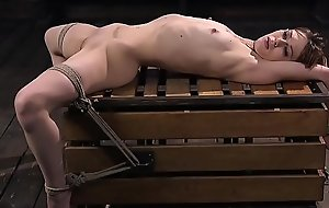 Hogtied petite slave gets whipped