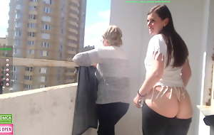 Girl shows tits and ass in font of old lady