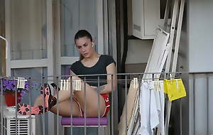 In the open girl relaxing on the balcony