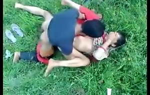 Indian MILF on green grass in open-air sex