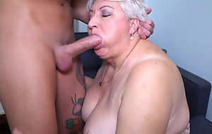 Big mom deep throats together with fucks her toyboy