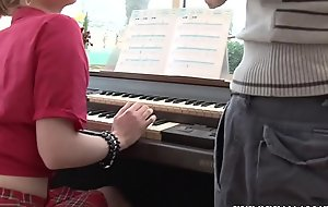 The music teacher as substantially as credo how to personate along to piano to along to young girl student also teaches her to have faith in along to nuisance